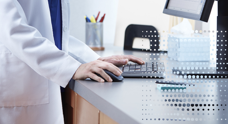 Doctor at desk using computer